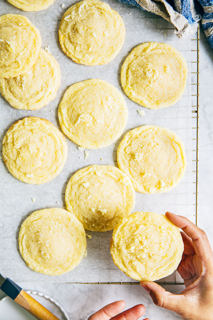 hands reaching for chewy lemon sugar cookies