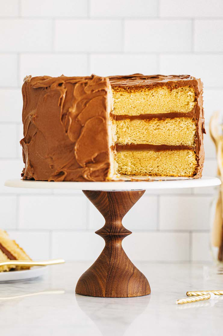 yellow cake with chocolate frosting sliced