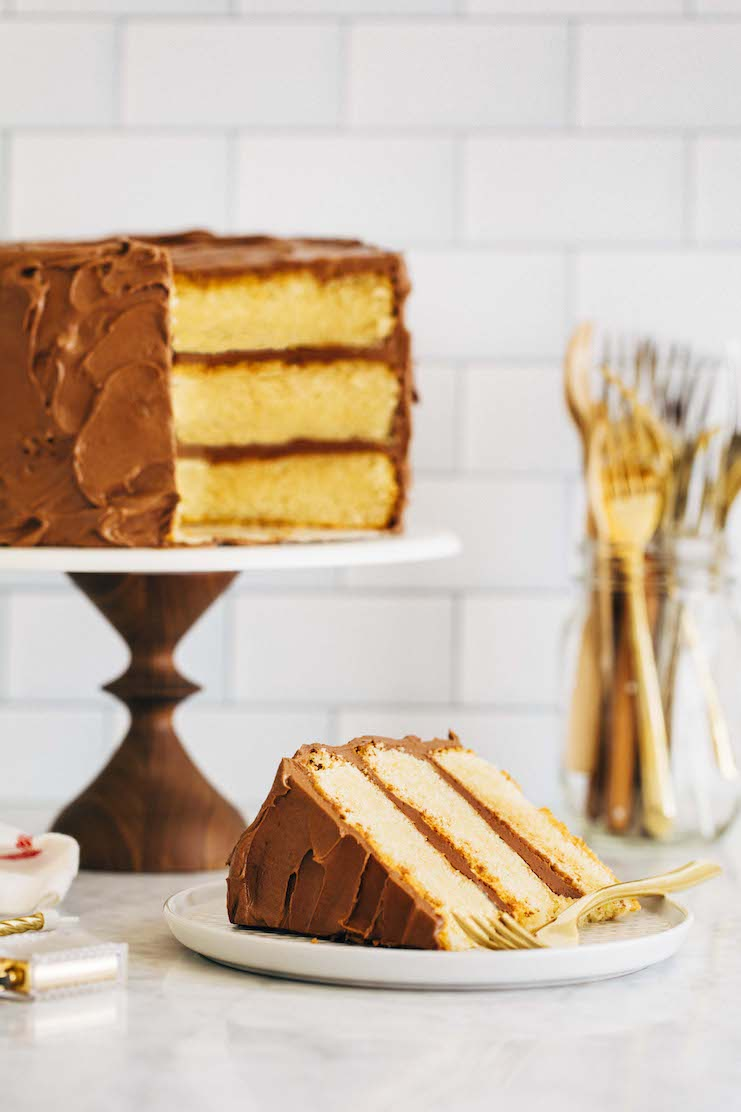 yellow cake with chocolate frosting slices