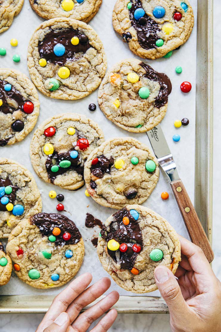 hands reaching for m&m cookies
